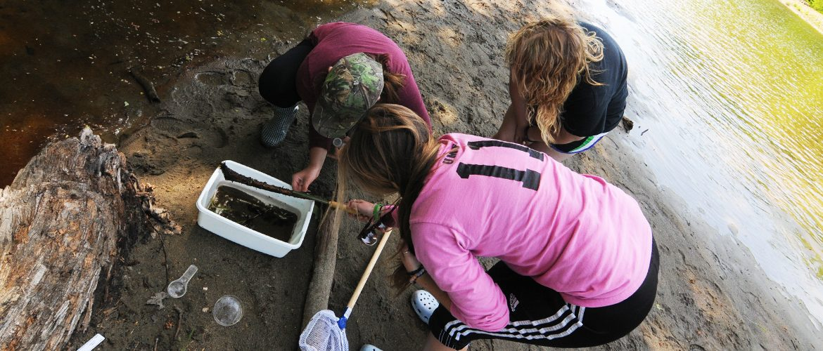 Students conducting outdoor science project at the Sandy River