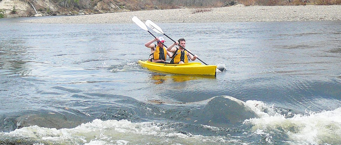 UMF student kayakers paddling the Sandy River