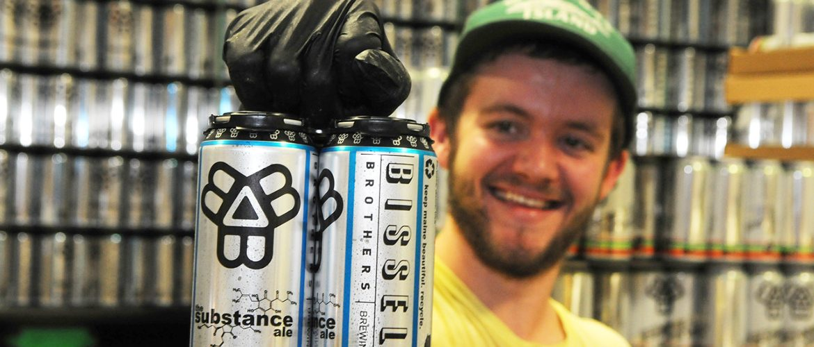 Male UMF alumni brewer and entrepreneur at the business he co-founded, Bissell Brothers Brewing Company