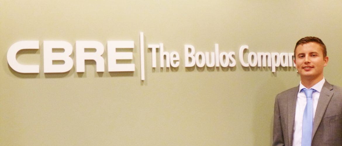 UMF alumnus Cole-Smith at his workplace, The Boulos Company, a national commercial real estate firm