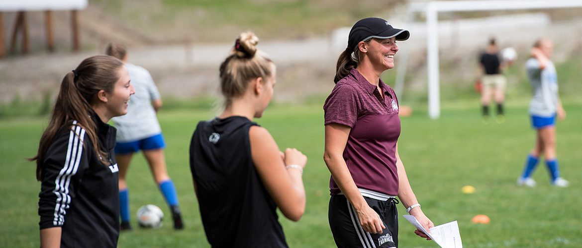 Women's soccer coach with UMF women's soccer team