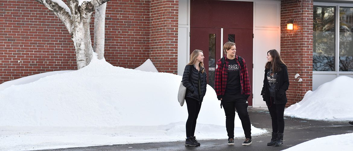 Three students near Roberts Learning Center