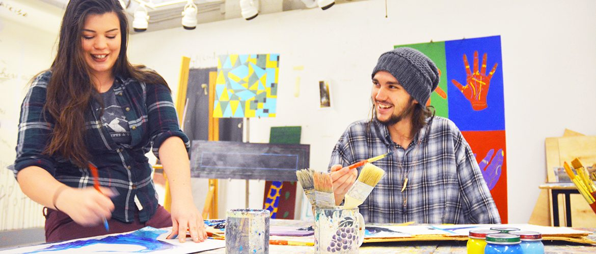 Two students in a campus art studio