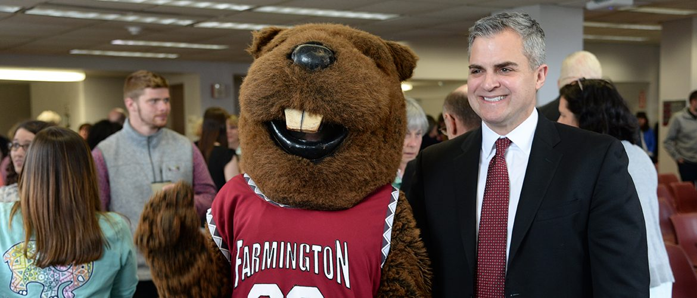 UMF President Edward Serna with UMF Beavers mascot, Chompers