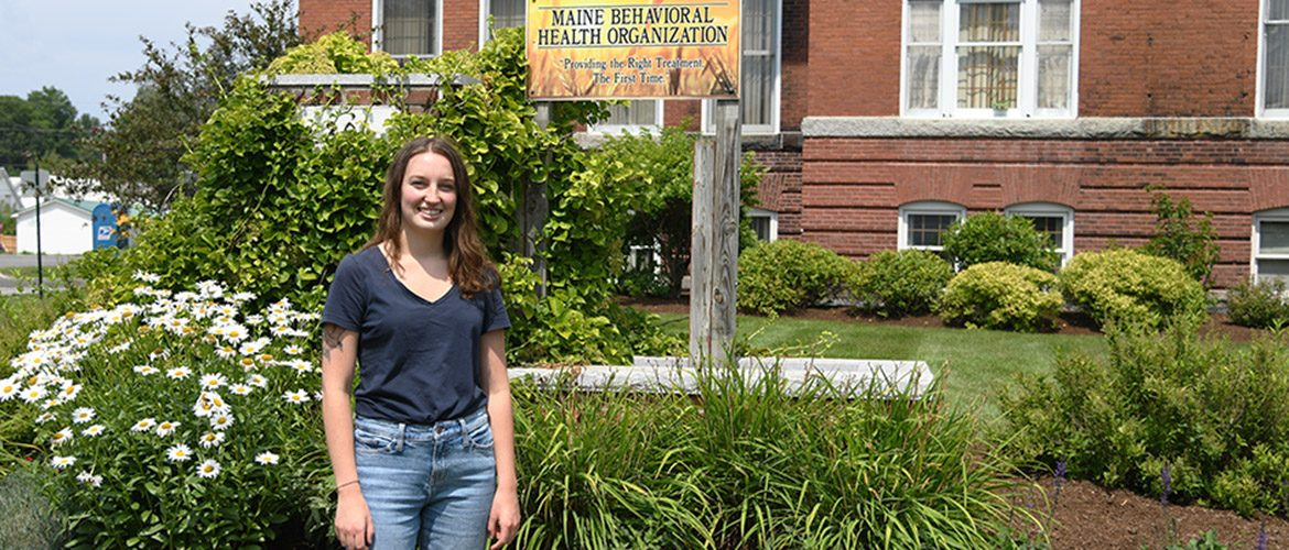 UMF graduate near her place of employment at Maine Behavioral Health Services
