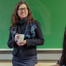 Professor at front of a classroom