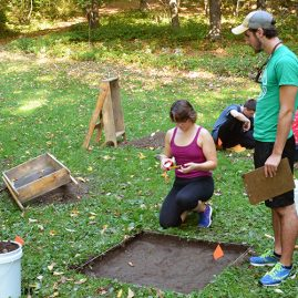 Students conducting an archaeological excavation