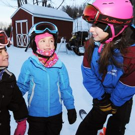 Woman student working with young skiers