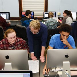 Professor and students working in New Media lab