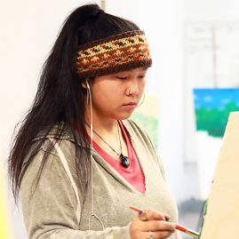 Art student painting in a studio