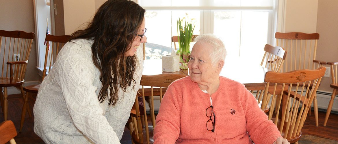 Student intern working with senior citizen at a local nursing home
