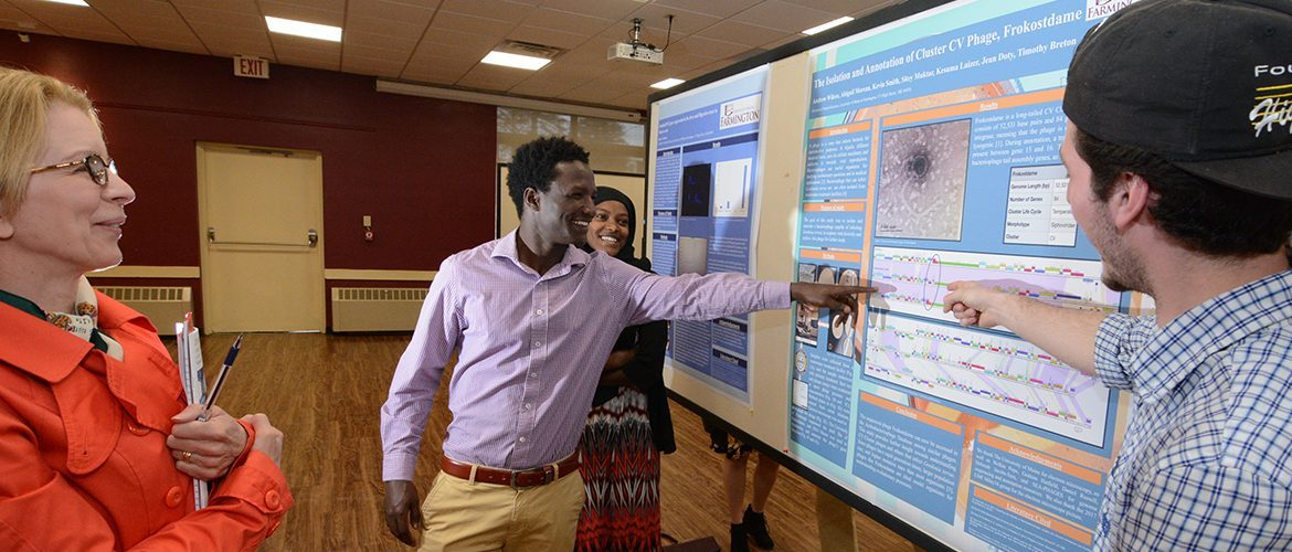 Student presenting a poster presentation at Symposuim Day