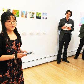 Student presenting her art work in UMF Art Gallery