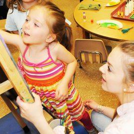 Female student working with preschool children