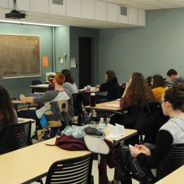 Professor teaching a classroom of students