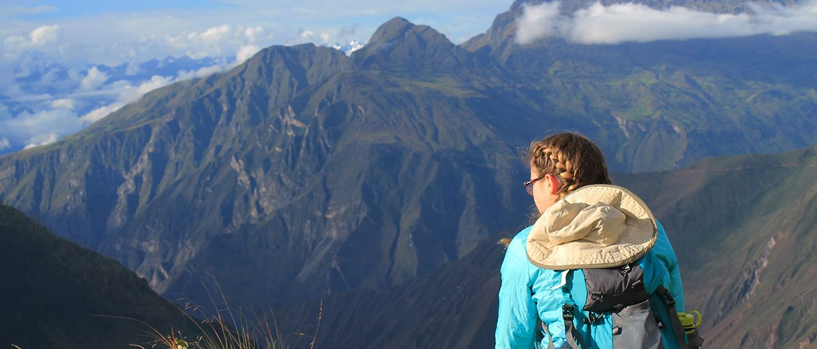 Student looking at mountain range in the Peruvian Andes