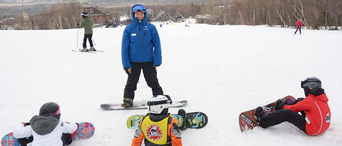 Student interning as children's ski instructor at Sugarloaf