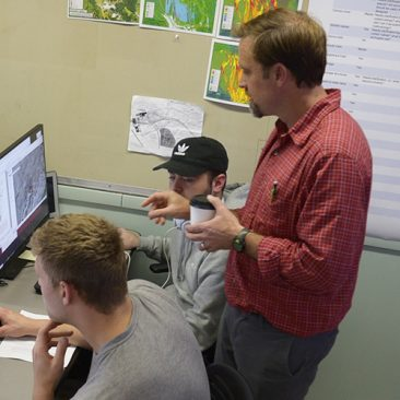 Students and professor in a GIS Lab