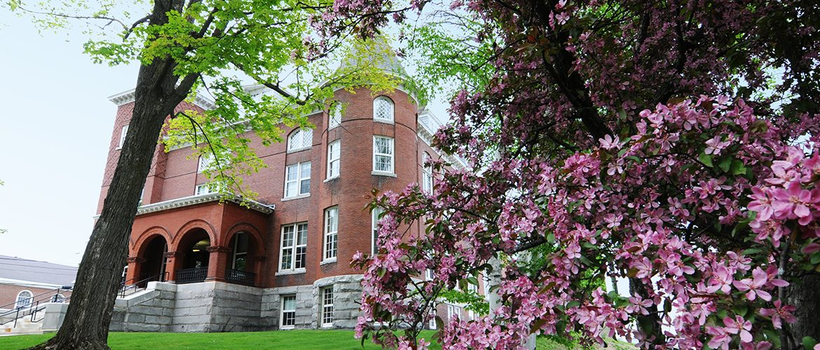 Outside view of Merrill Hall in springtime