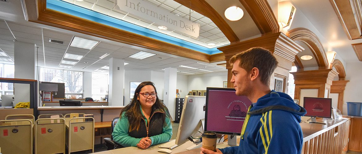 Student worker at Mantor Library assisting a student