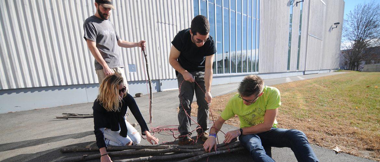 Group of students bundling wood specimens