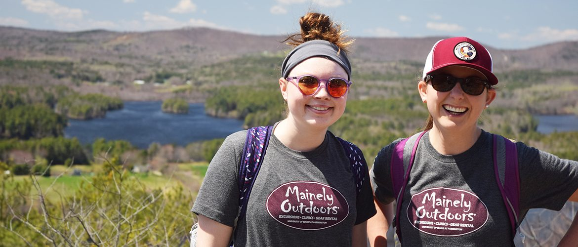 Two students on mountaintop after a hike