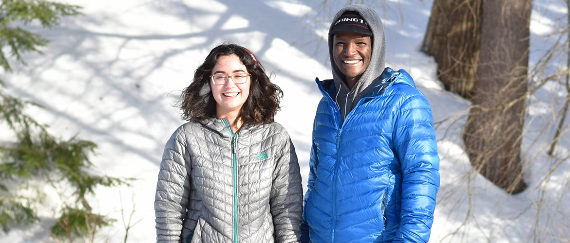 Two students standing in the snow