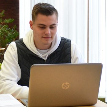 Male student on a laptop