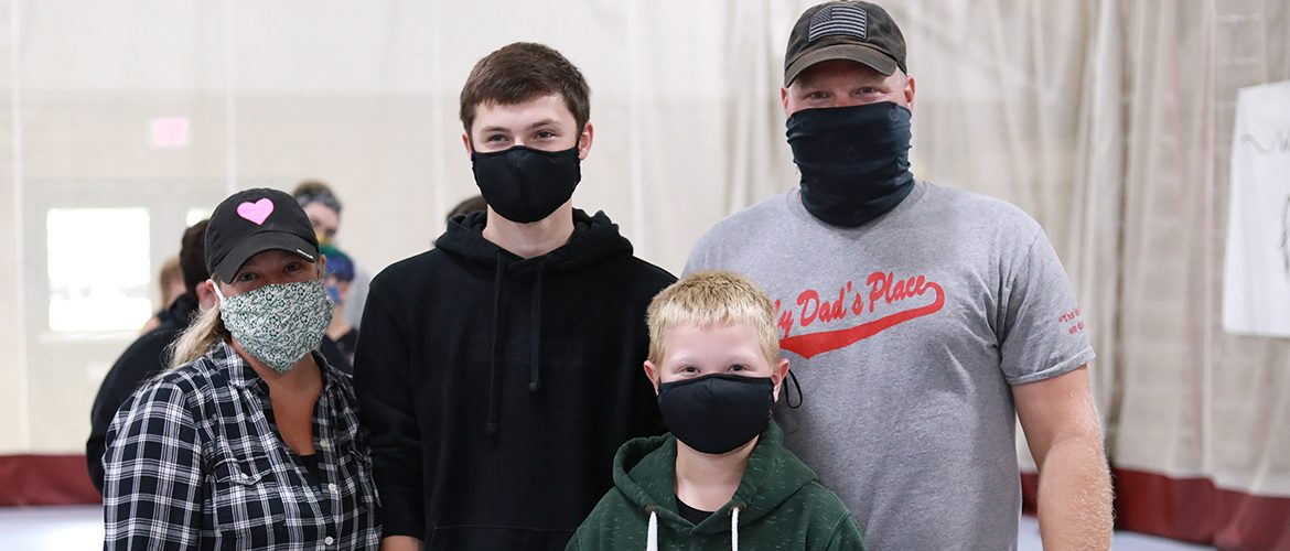 Student and family at Move-In day in masks