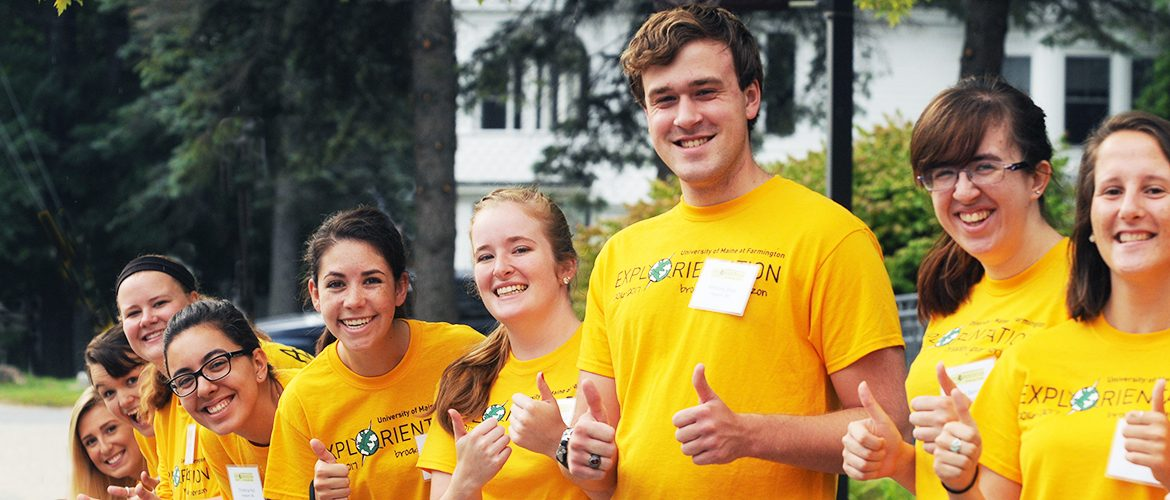 Students giving thumbs up at an Admissions event