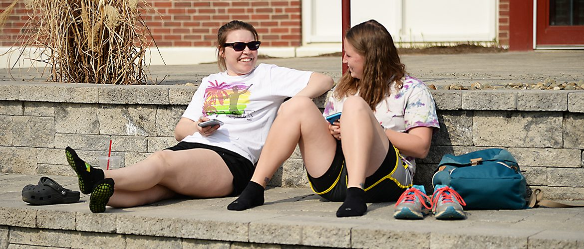 Students hanging out in the sun