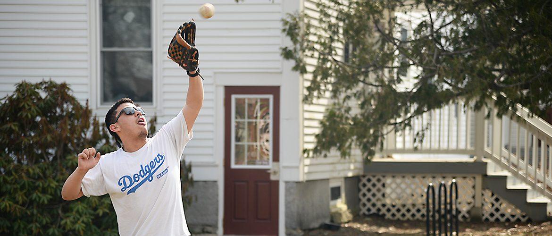 Student playing baseball catch