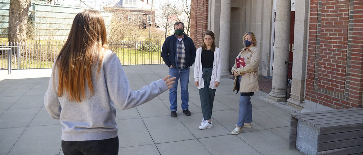 Prospective student and parents on a guided campus tour