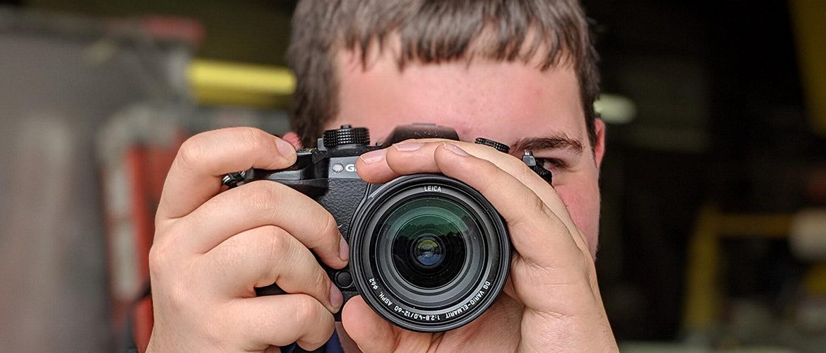 Student looking through a camera viewfinder