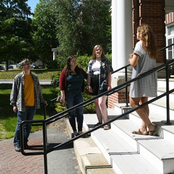 Family and student tour guide on a campus tour