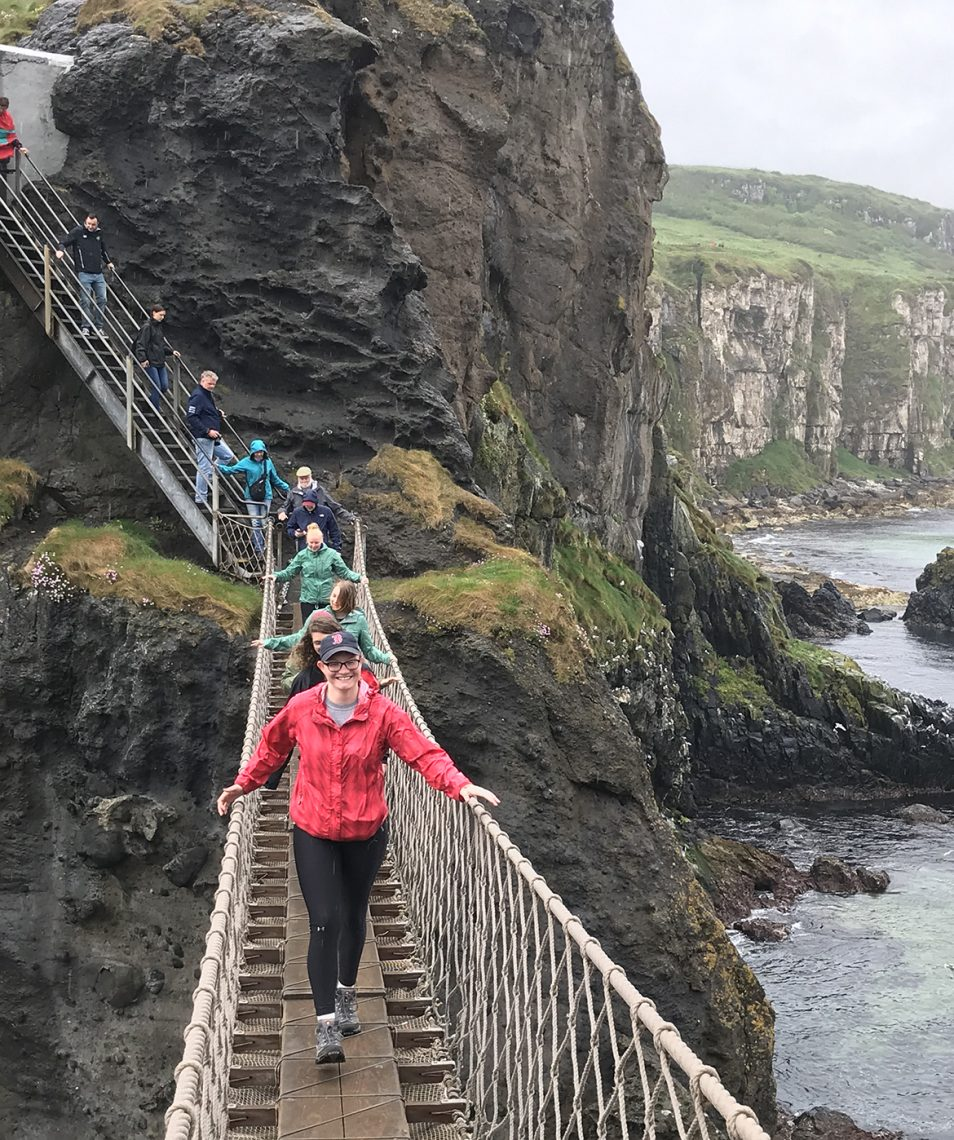 Crossing a rope bridge in Northern Ireland.