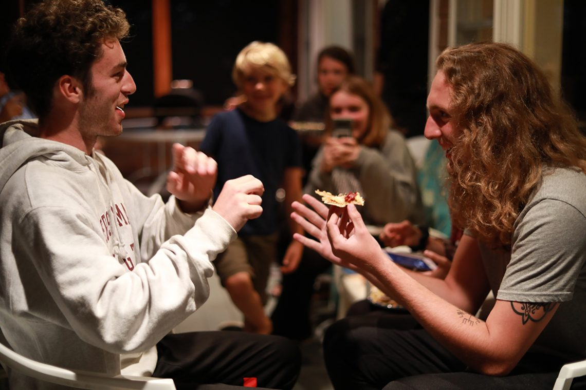Connor McBrady and Cameron McLaughlin share a laugh and bond over cauliflower-crust pizza.