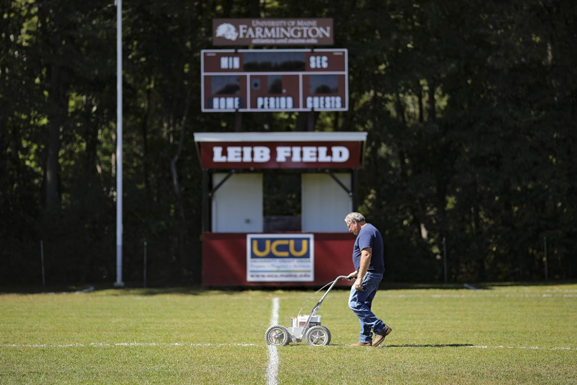 Mark Tyler lays down a line of paint on Leib Field