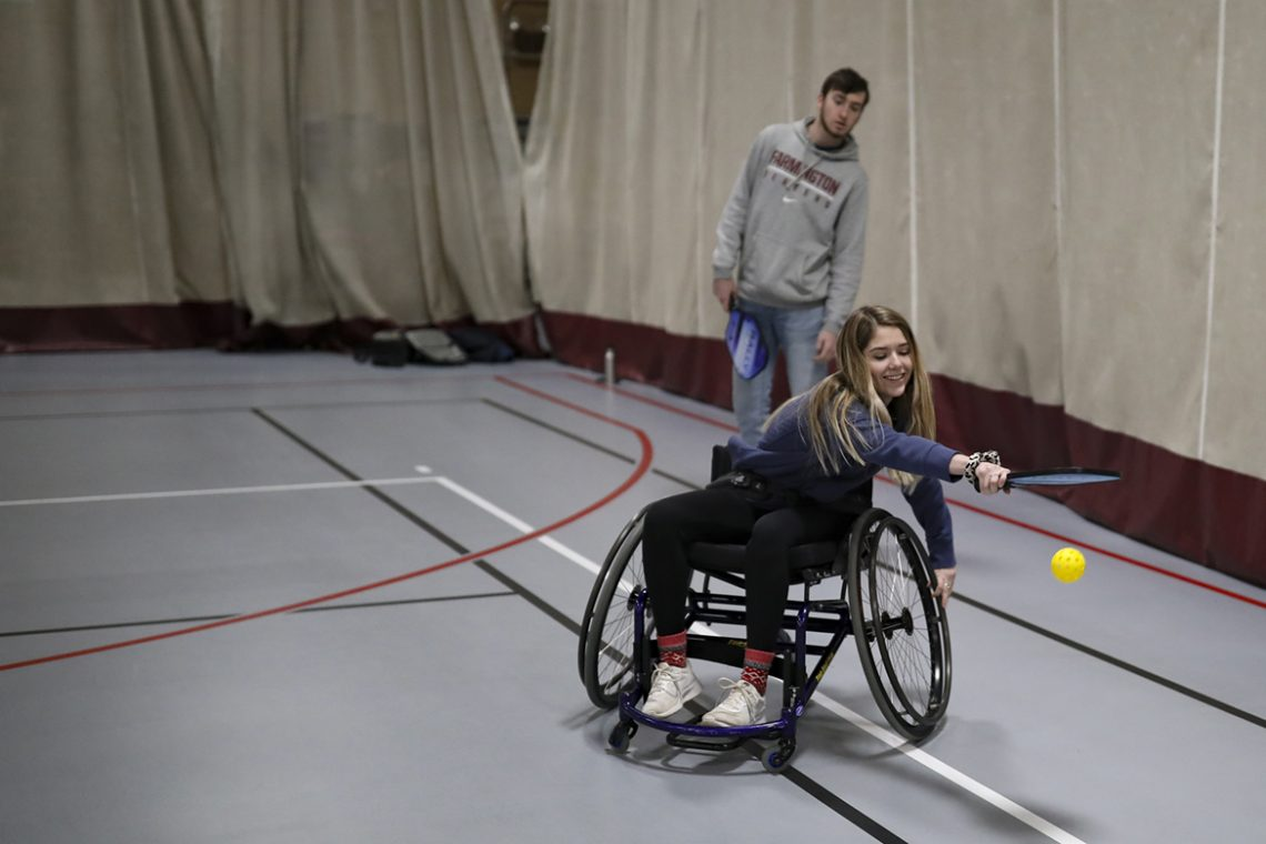 Kelsey Sullivan plays pickleball while using a wheelchair.