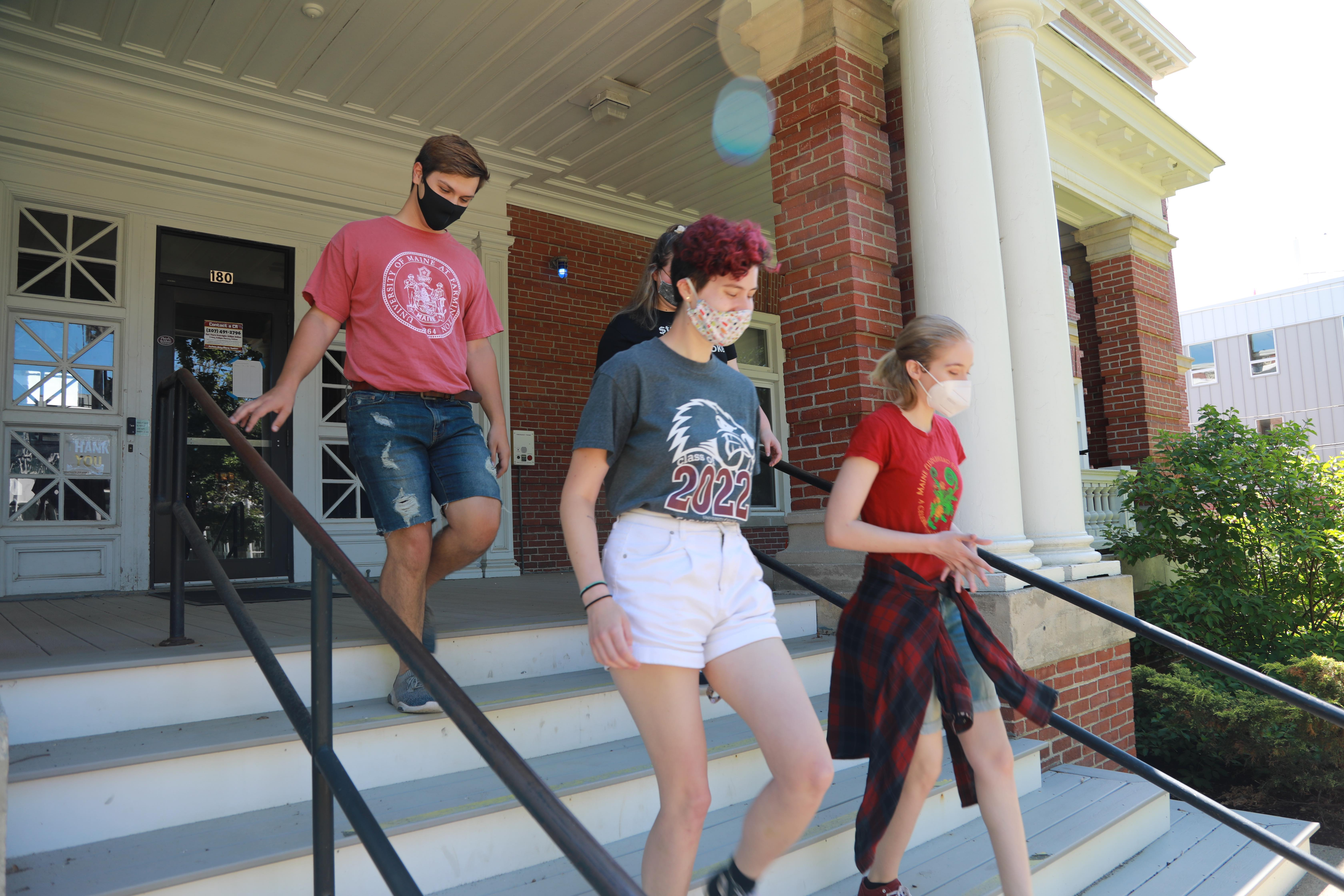 Masked students leaving residence hall