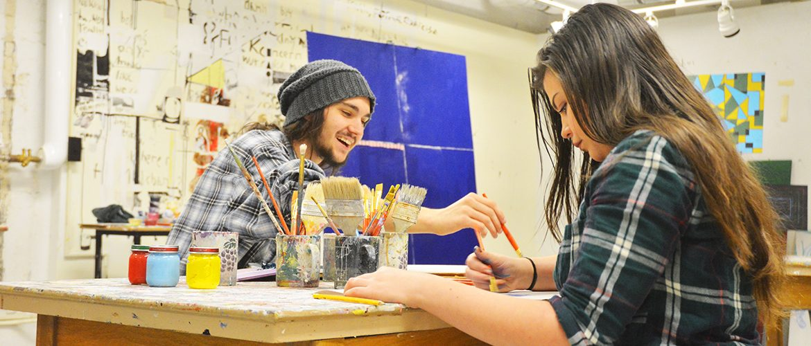 Students making art in an on-campus art studio