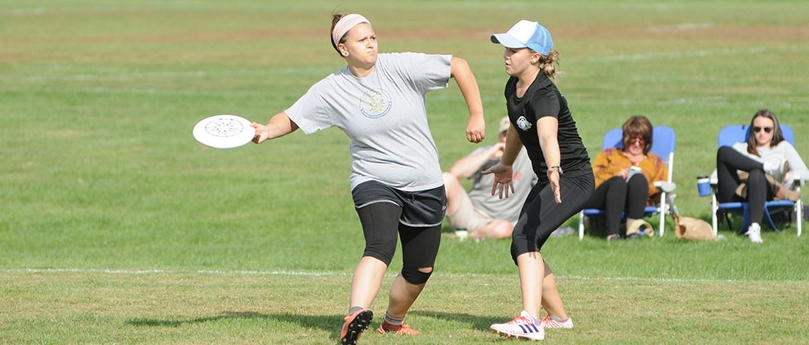 Students playing in a Club Ultimate Disc tournament