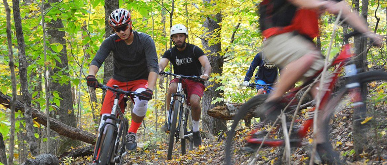 Students mountain biking near campus