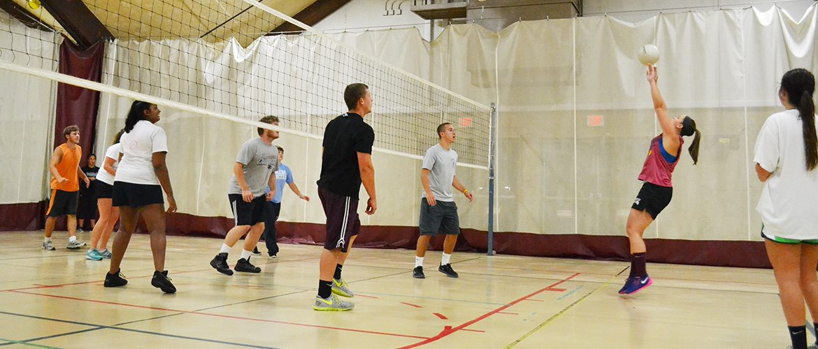 Students playing intramural volleyball in the Fitness and Recreation Center