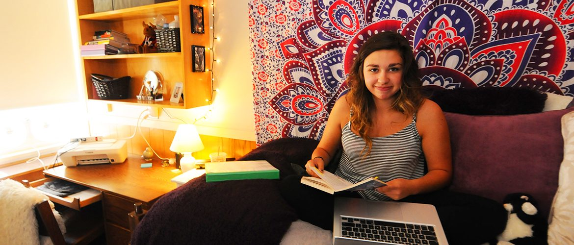Student in her residence hall room