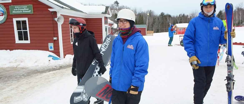Students going snowboarding and skiing at Farmington's Titcomb Mountain