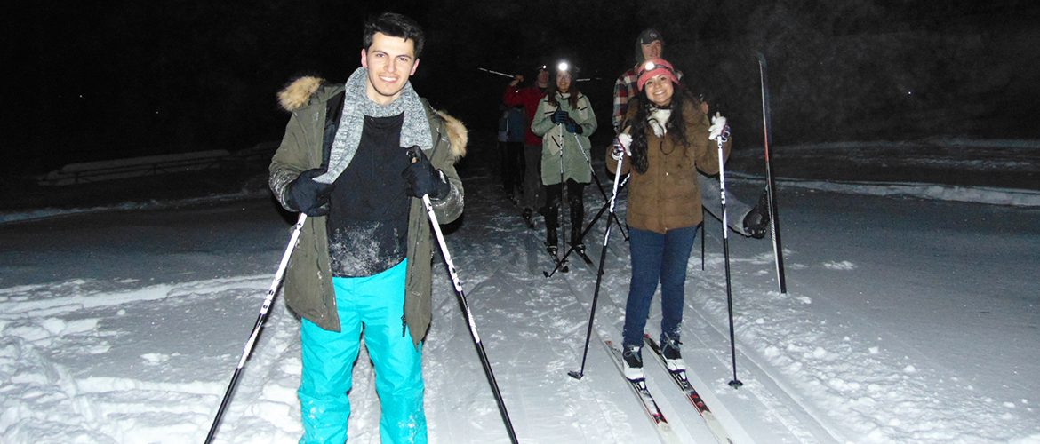 Students nighttime Nordic skiing at UMF's Prescott Field