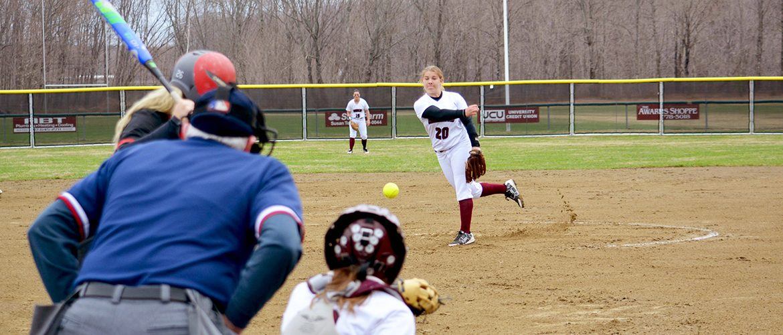 Women's softball pitcher pitching the ball