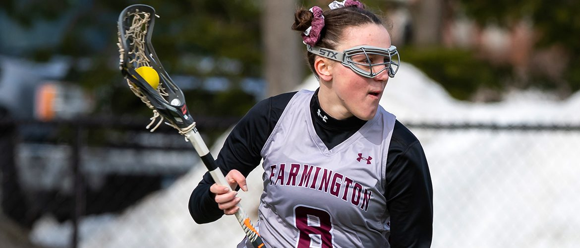 Woman lacrosse player in action