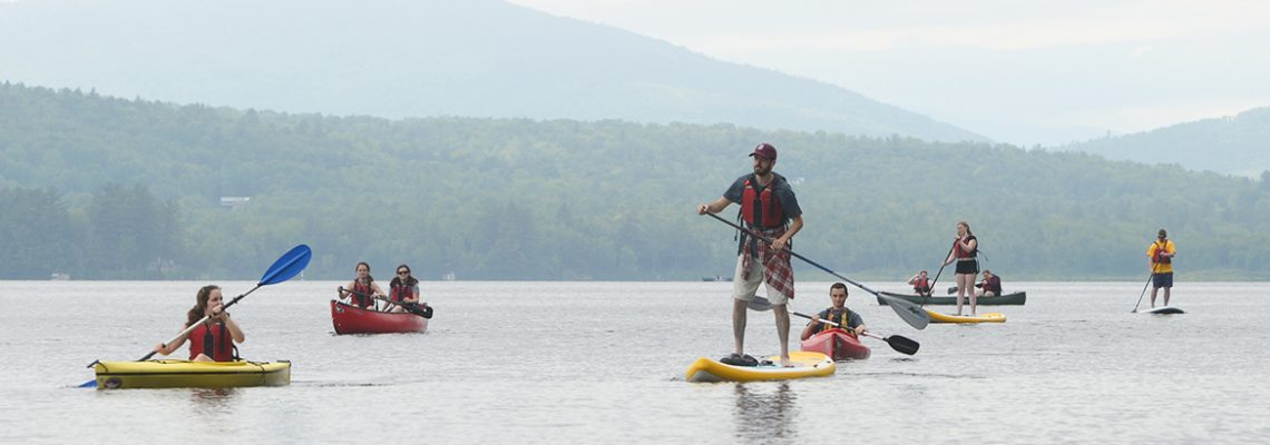 Students kayaking and paddleboarding on Wilson Lake